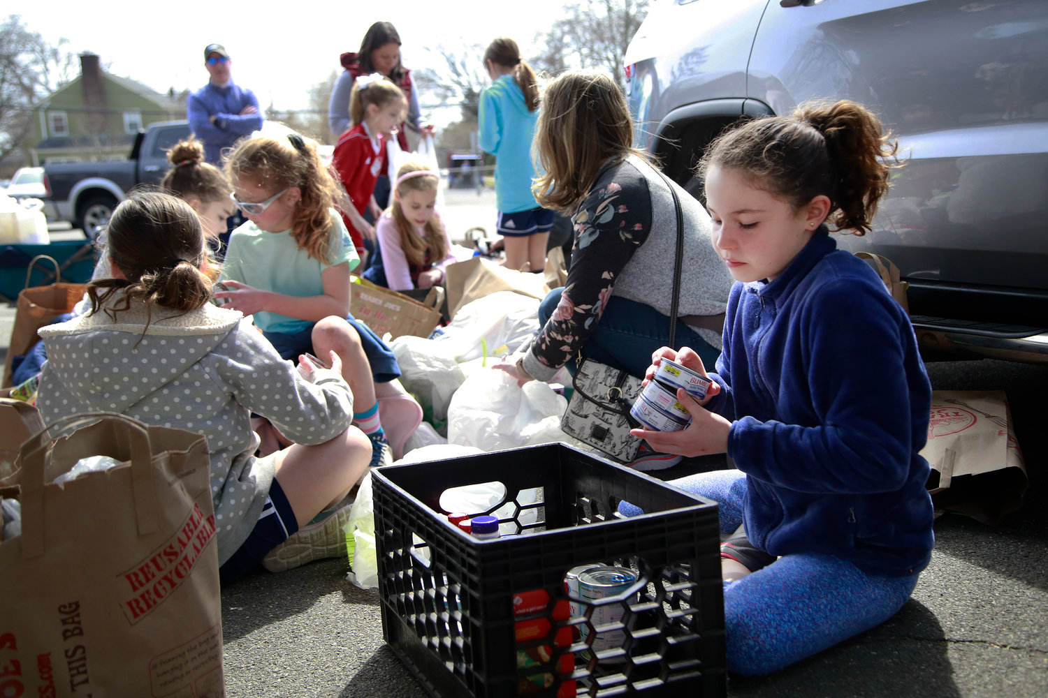 Fourth grader Grace Adler helped organize items for her team, Friends in Need.