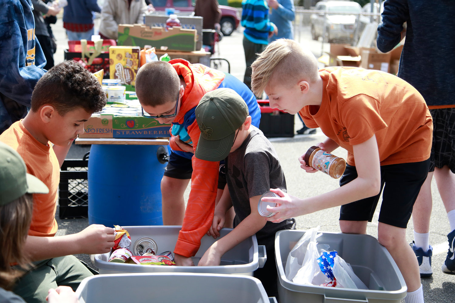 "Fabien Rivera, Brian Guikeen and Nicolas Prizzi of team ""Troop 24"" along with help from Peter Signora, sort thru donations."
