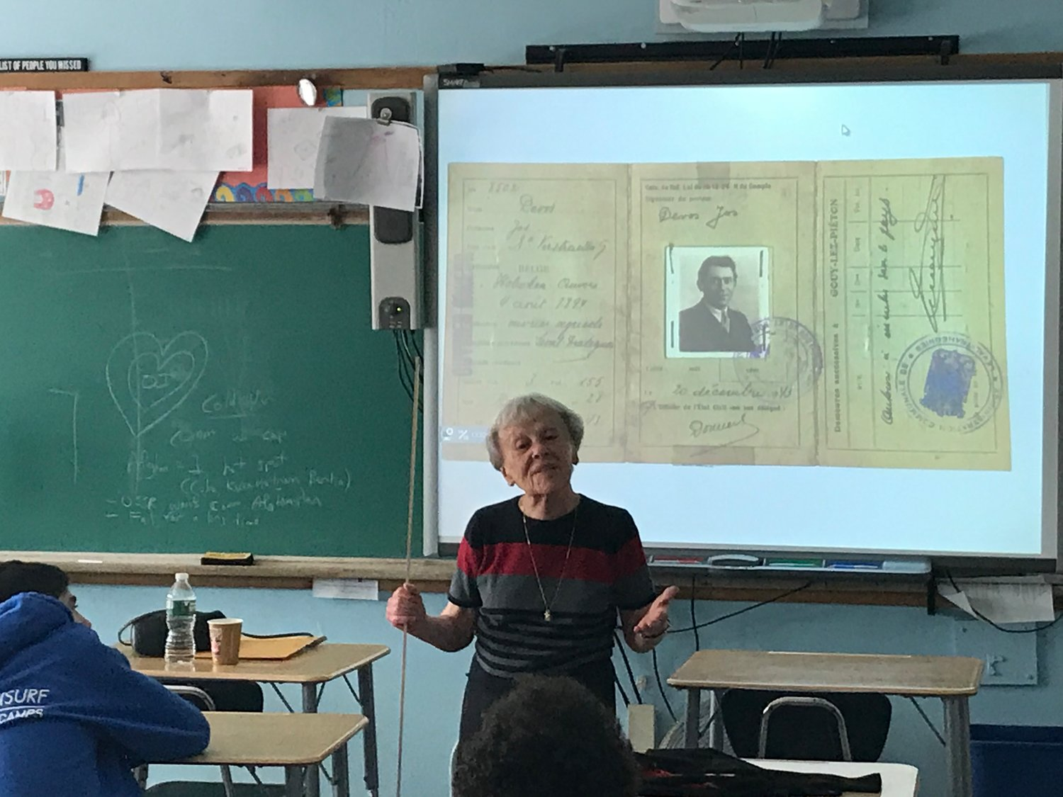Anna Levendel, a retired OHS teacher whose family hid in Belgium during the Holocaust, shared her story.