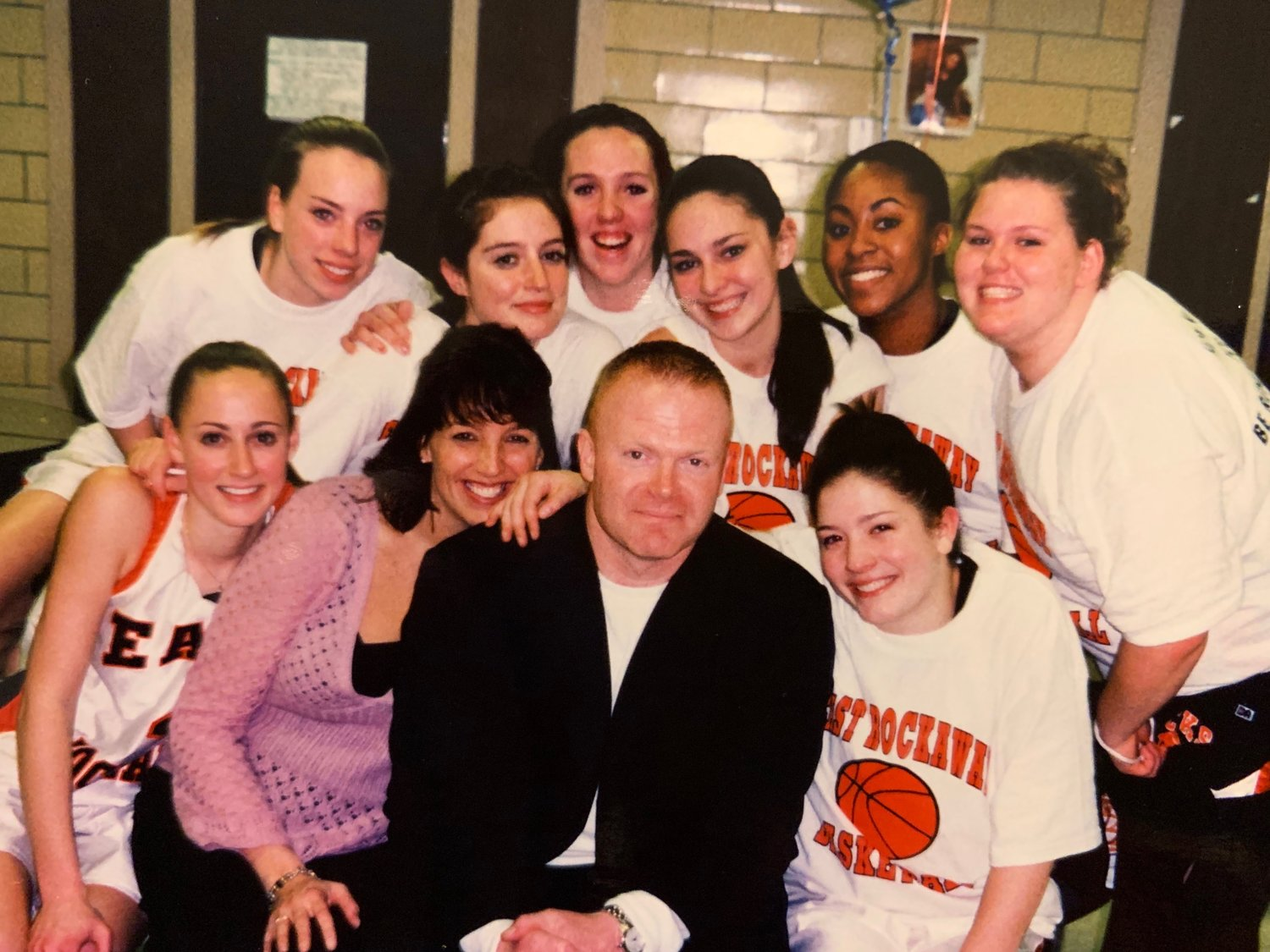 Leary, in pink, assistant coach Tim O'Hagan and the senior members of the 2005-06 team after it clinched the Conference C championship.