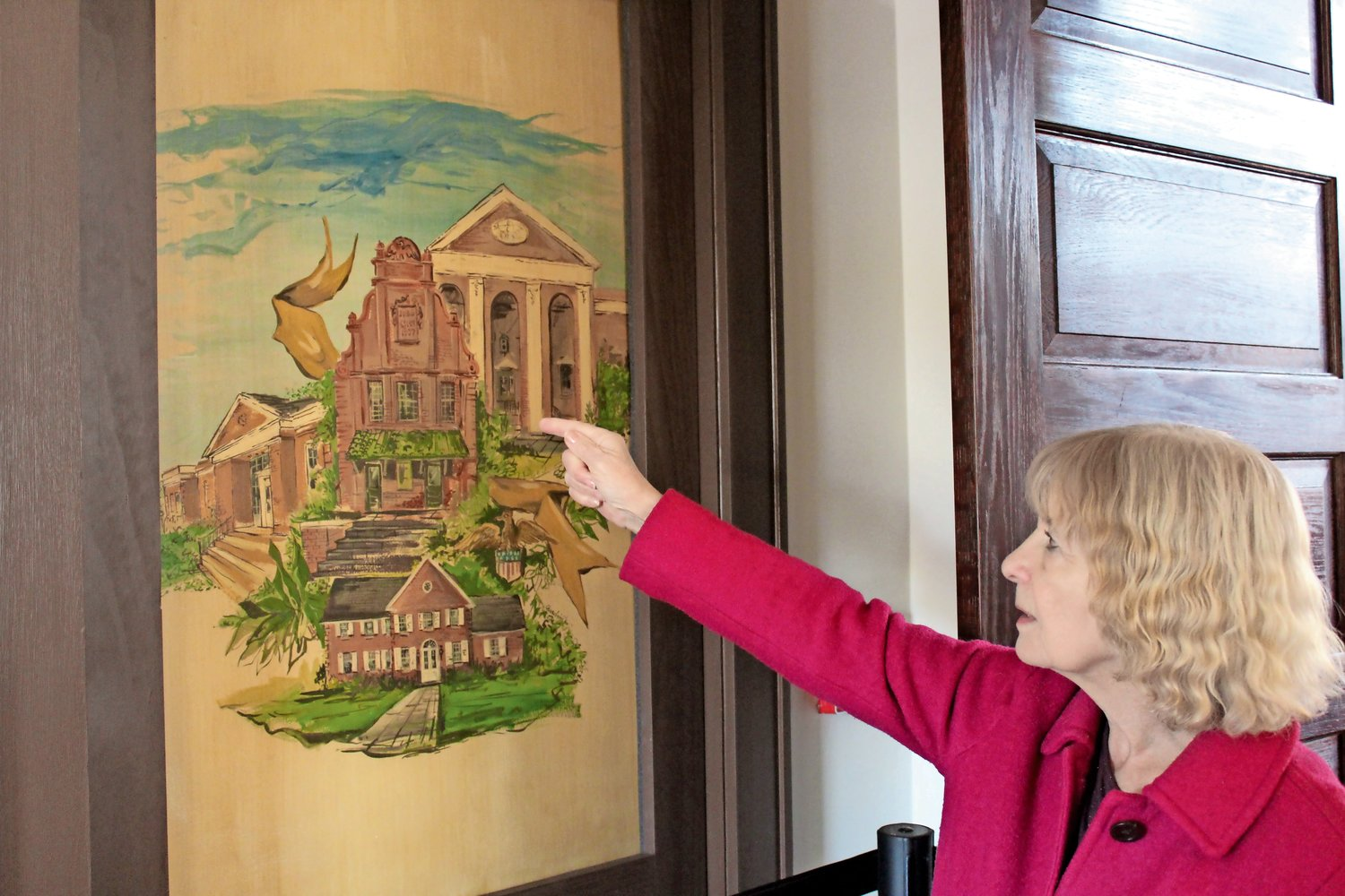 Museum President Georgie Connett pointed out a door panel in the museum that features major city landmarks.