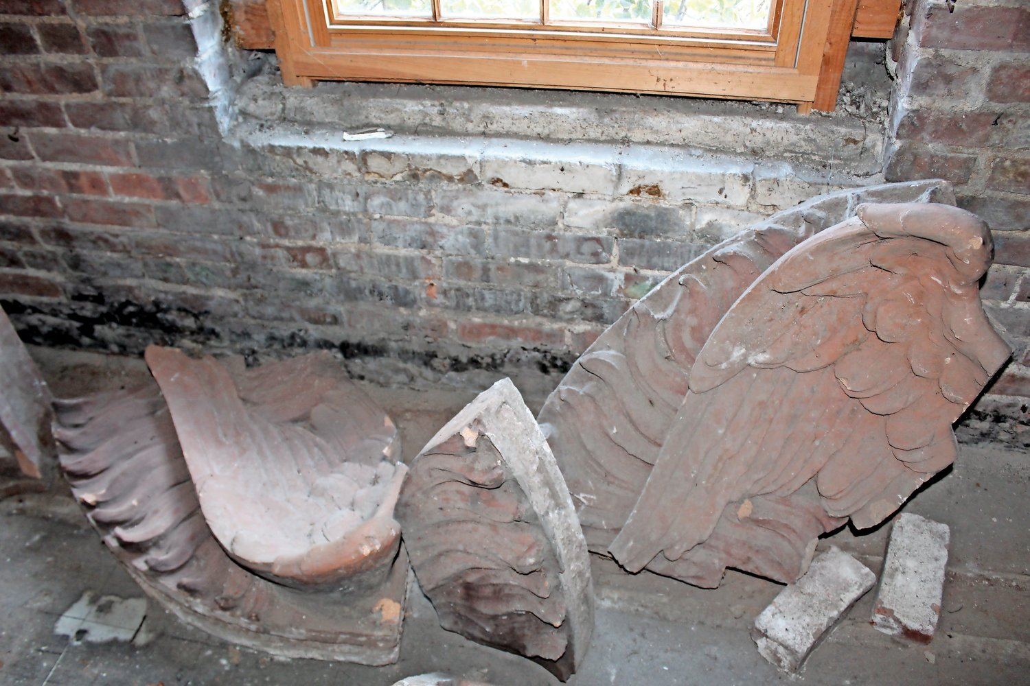 A pair of eagle wings, now collecting dust in the basement, will soon crown the façade.
