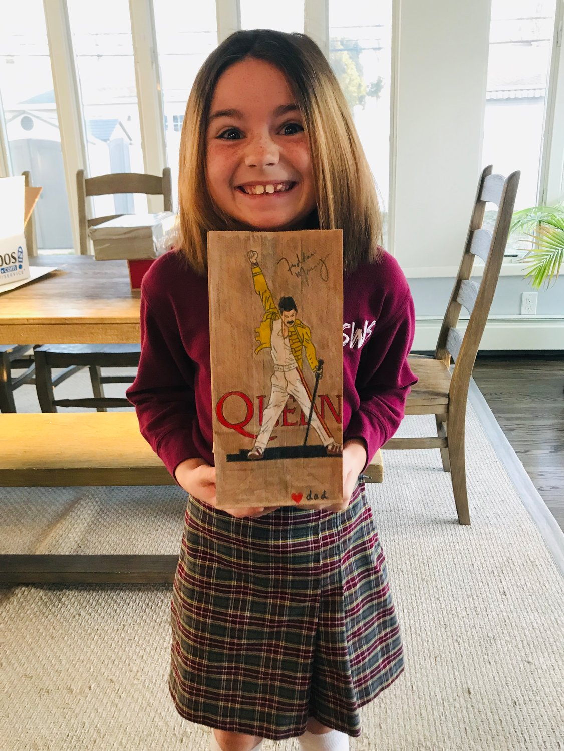 Molly with her Freddie Mercury bag, created by her father one day last week.