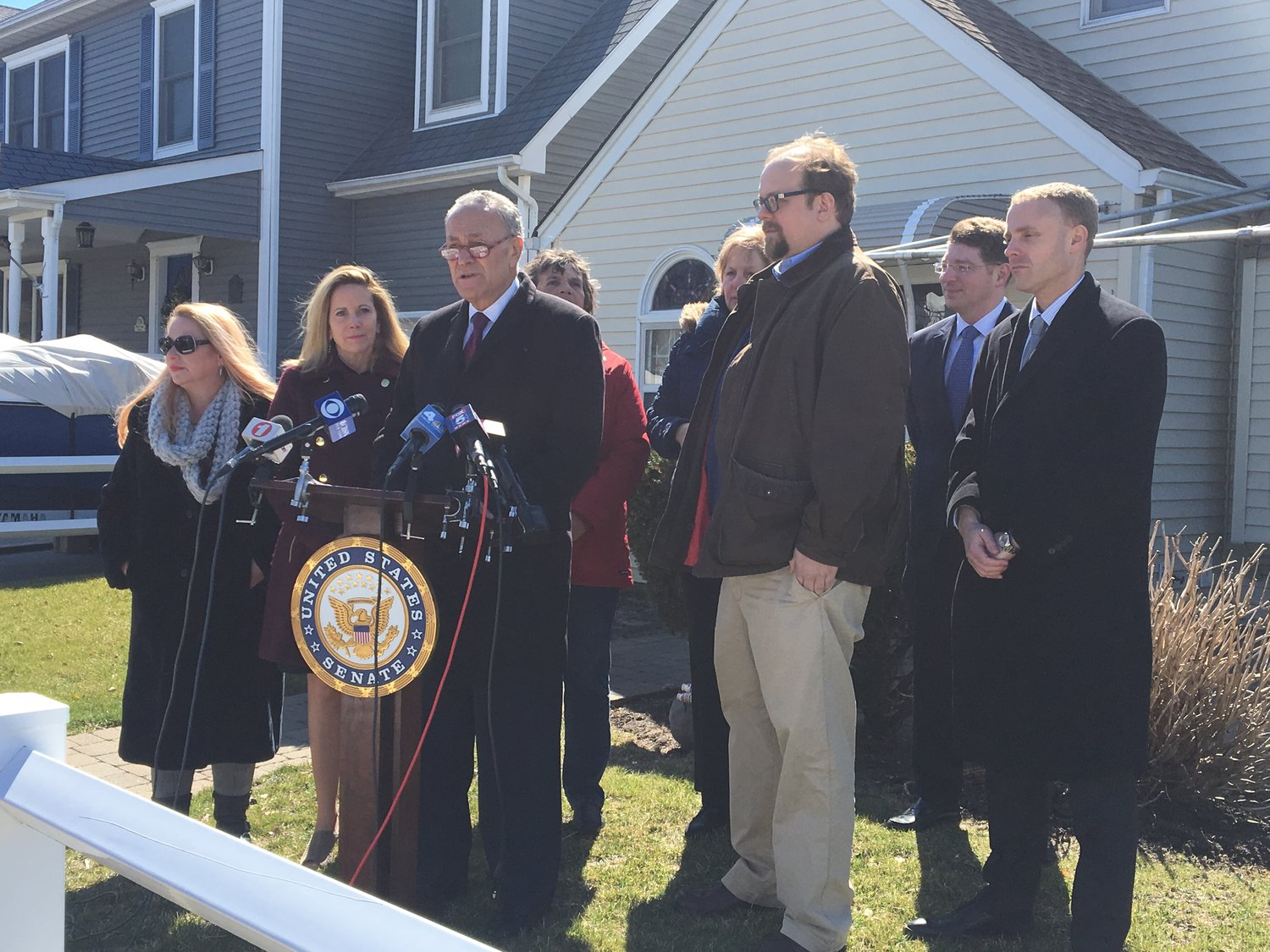 U.S. Sen. Charles Schumer was joined by residents and other elected officials in Long Beach on Monday to call on the Federal Emergency Management Agency to reconsider proposed changes to the National Flood Insurance Program.