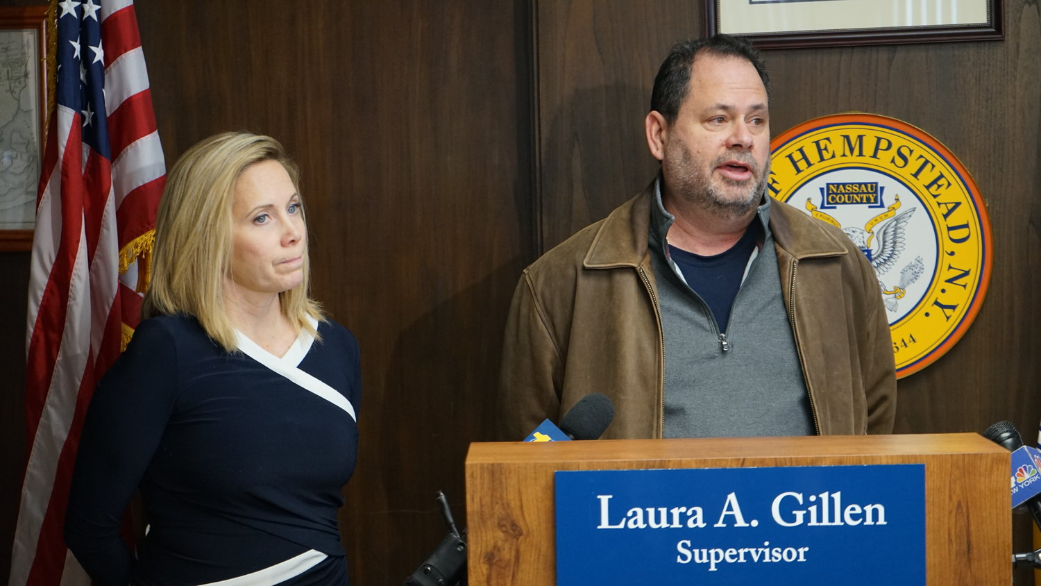 Town Supervisor Laura Gillen with Oceanside homeowner Michael Cascio in January. Cascio was told five years after Hurricane Sandy that he needed to elevate his house because of damage it sustained during the storm.