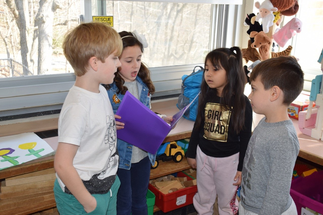 Simon Zaikowski , far left, and Gianna Calonita explained the mechanics of the project to Mackenzie Mora and Dylan Grieco.