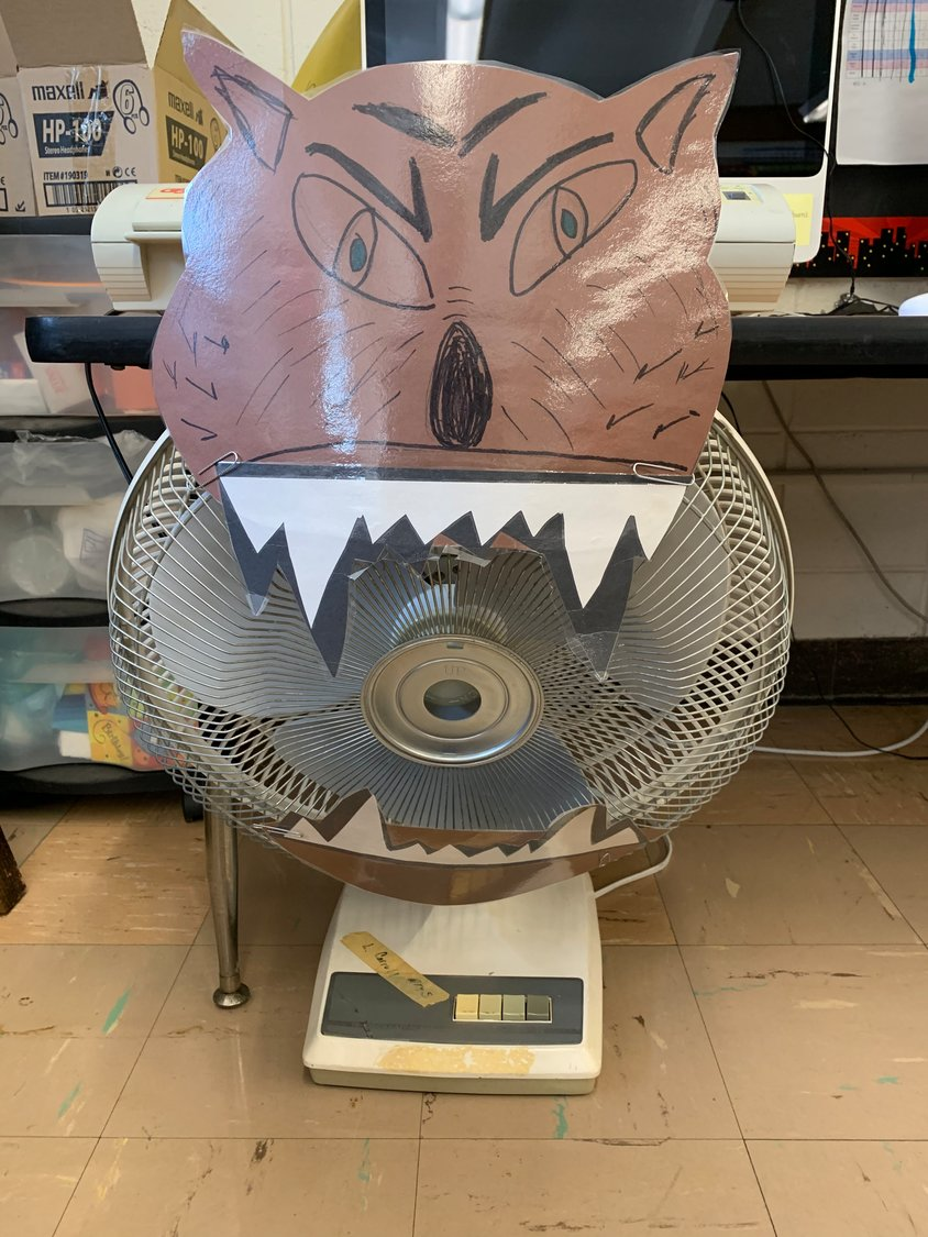 Students put their houses to the test against a fan dressed as the Big Bad Wolf.