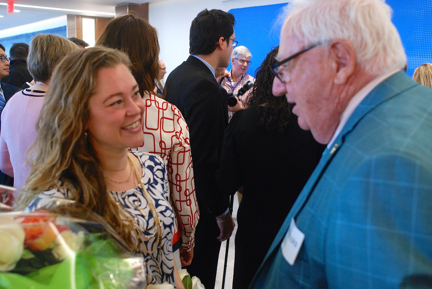 Stacy Miranda, of Long Beach, who was successfully treated for breast cancer at Memorial Sloan Kettering Cancer Center, chatted with State Sen. John Brooks, of Seaford, after she gave a keynote speech at the grand-opening ceremony for MSK's newest center, on Hempstead Turnpike in Uniondale.