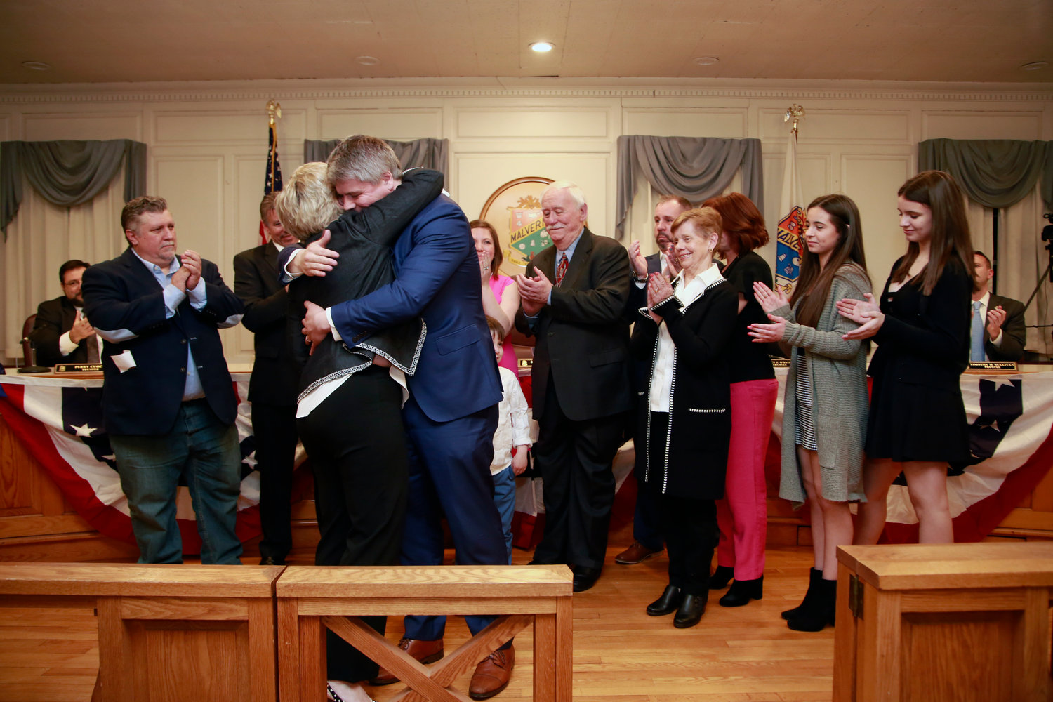 Malverne Mayor Keith Corbett hugged former mayor Patti Ann McDonald after she swore him in on April 2 at Village Hall.