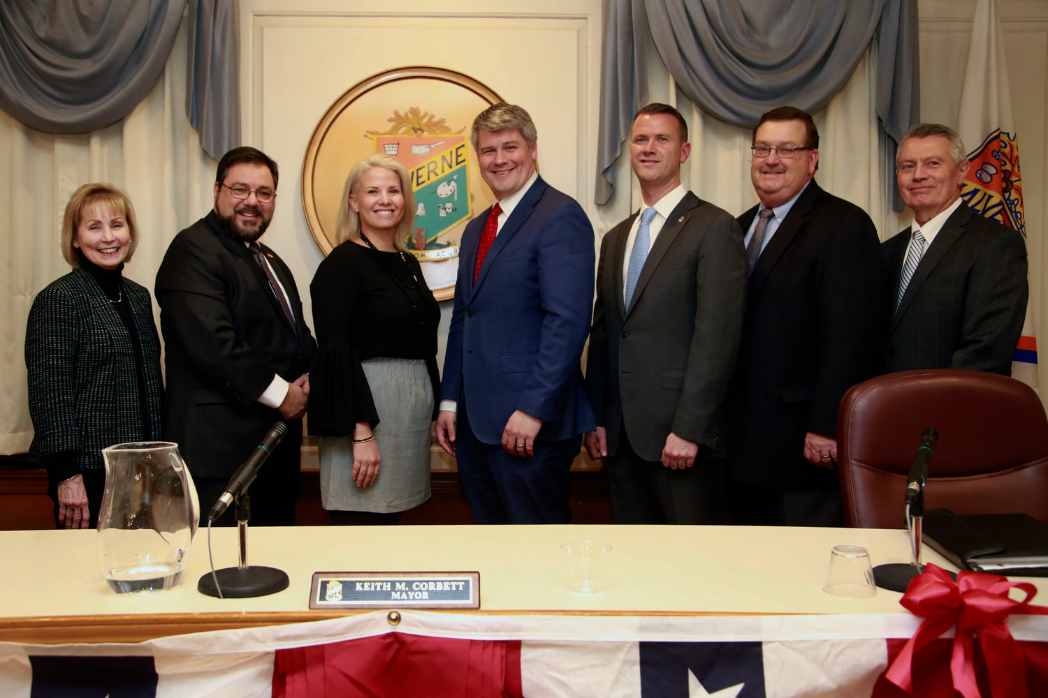 Malverne's village board, from left: Village Clerk Terry Emmel, Trustees Perry Cuocci and Lauren Touchard, Mayor Keith Corbett, Trustees Tim Sullivan and John O'Brien, and Village Justice James Frankie.