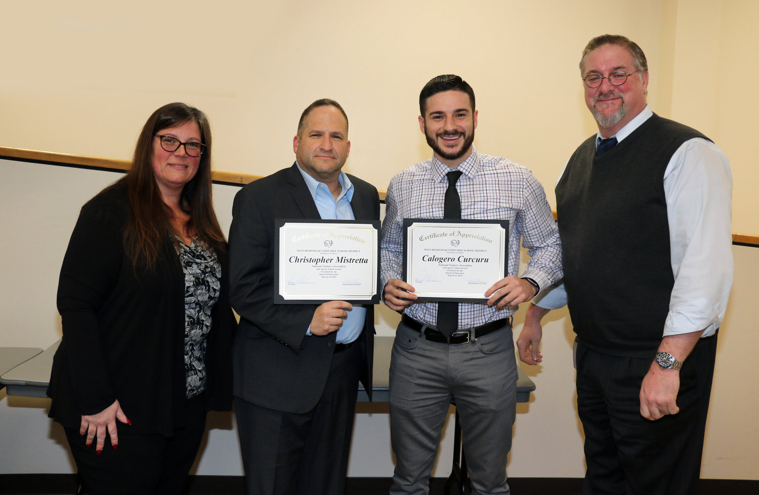 West Hempstead Board President Karen Brohm and district Superintendent Daniel Rehman, far right, congratulated Athletic Director Chris Mistretta and Athletic Trainer Calogero Curcuru for receiving the NATA Safe Sports School award on March 19.