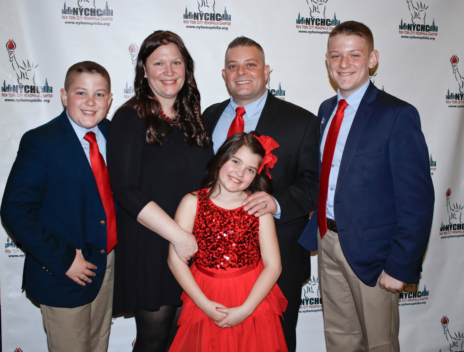 Christopher's Hemophilia Benefit was started 11 years ago in honor of Christopher, Ambrosio, right, who was born with the genetic bleeding disorder. Above, Christopher at the March 29 event with, from left, his brother, Connor, his mother, Kelly, his sister, Kelsey, and his father, Danny.