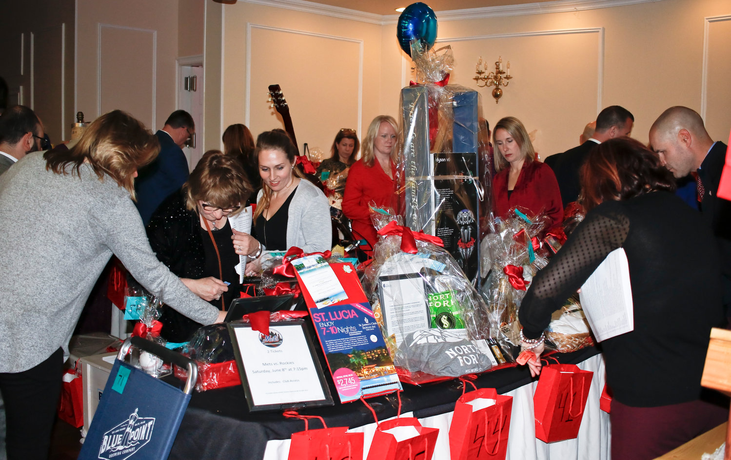 Guests browsed the grand prize raffles, which included cruises, sports packages and a guitar.