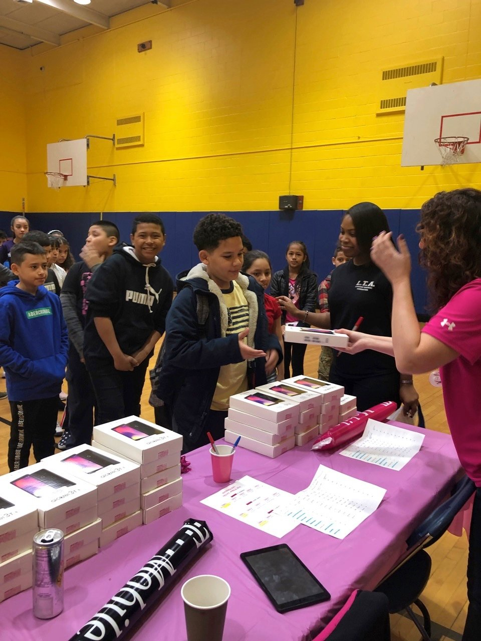 Lawrence Elementary fifth-grade student Joshua Cruz was one of 550 students to receive an Android Wi-Fi device from T-Mobile on April 5.