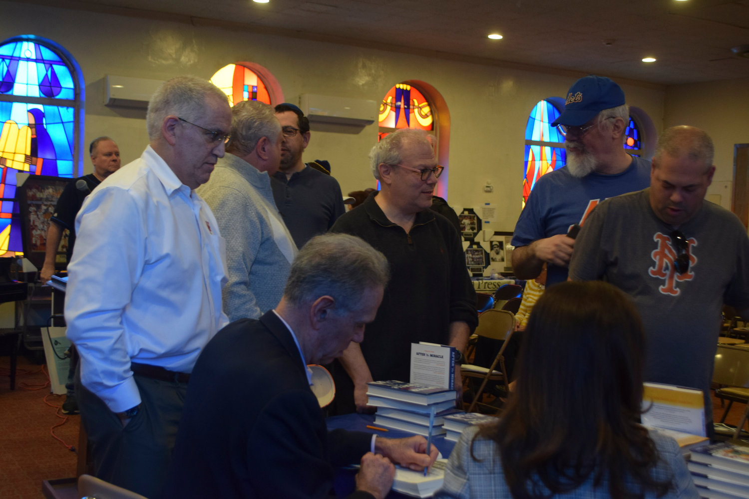 Former New York Mets player Art Shamsky signed one of his two books at Temple Israel on April 7.