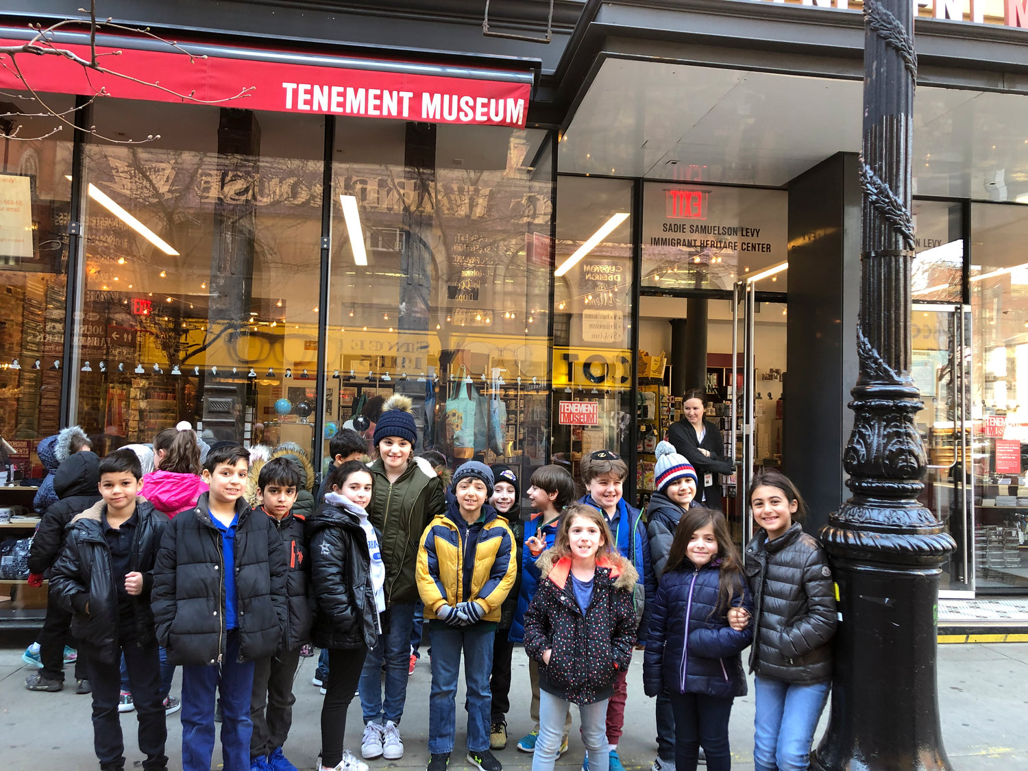 Outside the Tenement Museum in New York City, Brandeis students appeared happy they spent the day outside of school.