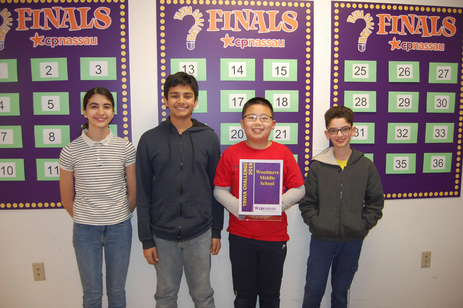 Woodmere Middle School students Leeya Azemoun, left, Ibrahim Rasheed, Brian Chen and Ethan Abeler were the winners of the CP Nassau seventh/eighth grade 2019 Trivia Challenge.
