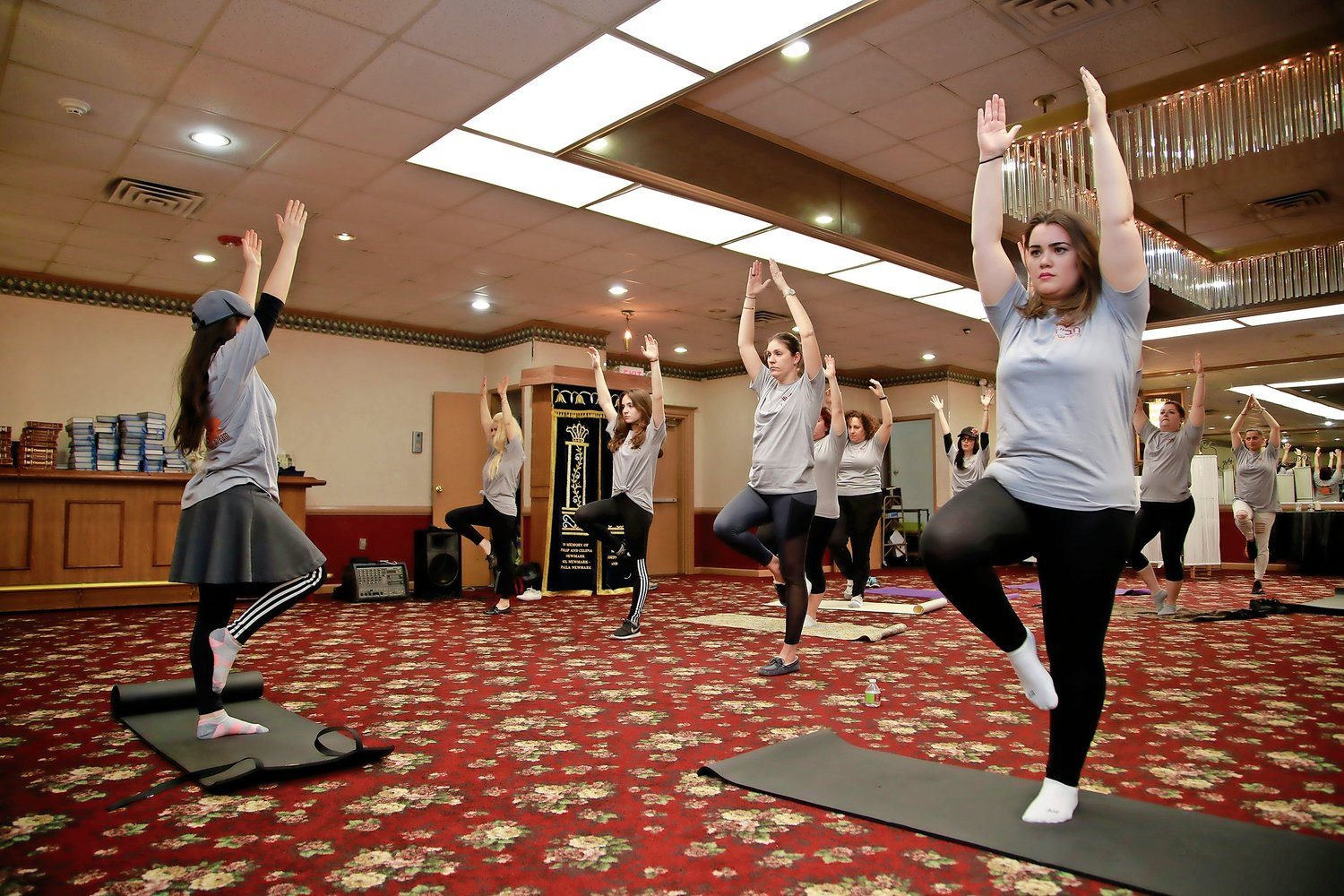 Barbara Mezrahi, far left, led the Chabad Women's Circle in yoga at the Chabad of Valley Stream's pre-Passover event on April 3.