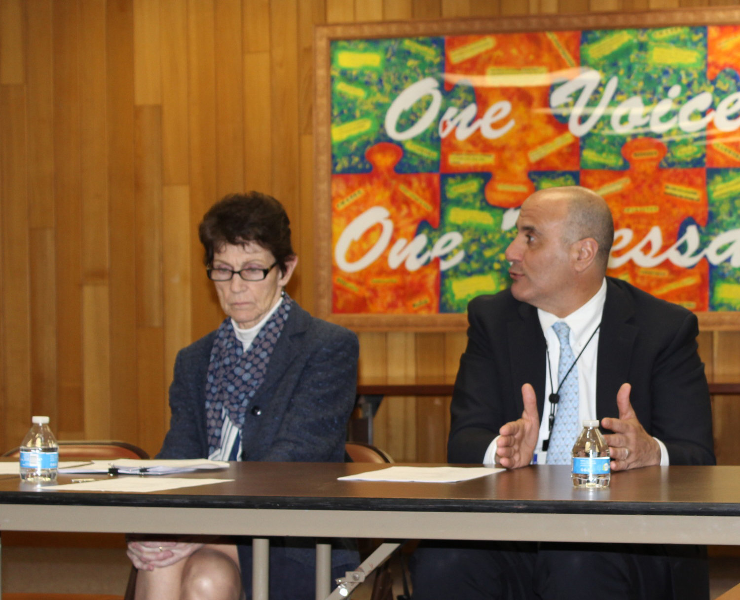 Kate Freeman, near right, pictured last year, led a breakdown of the proposed 2019-20 district budget at this month's board of education meeting. Superintendent John DeTommaso, far right, said he was excited about some of the district's new programs.