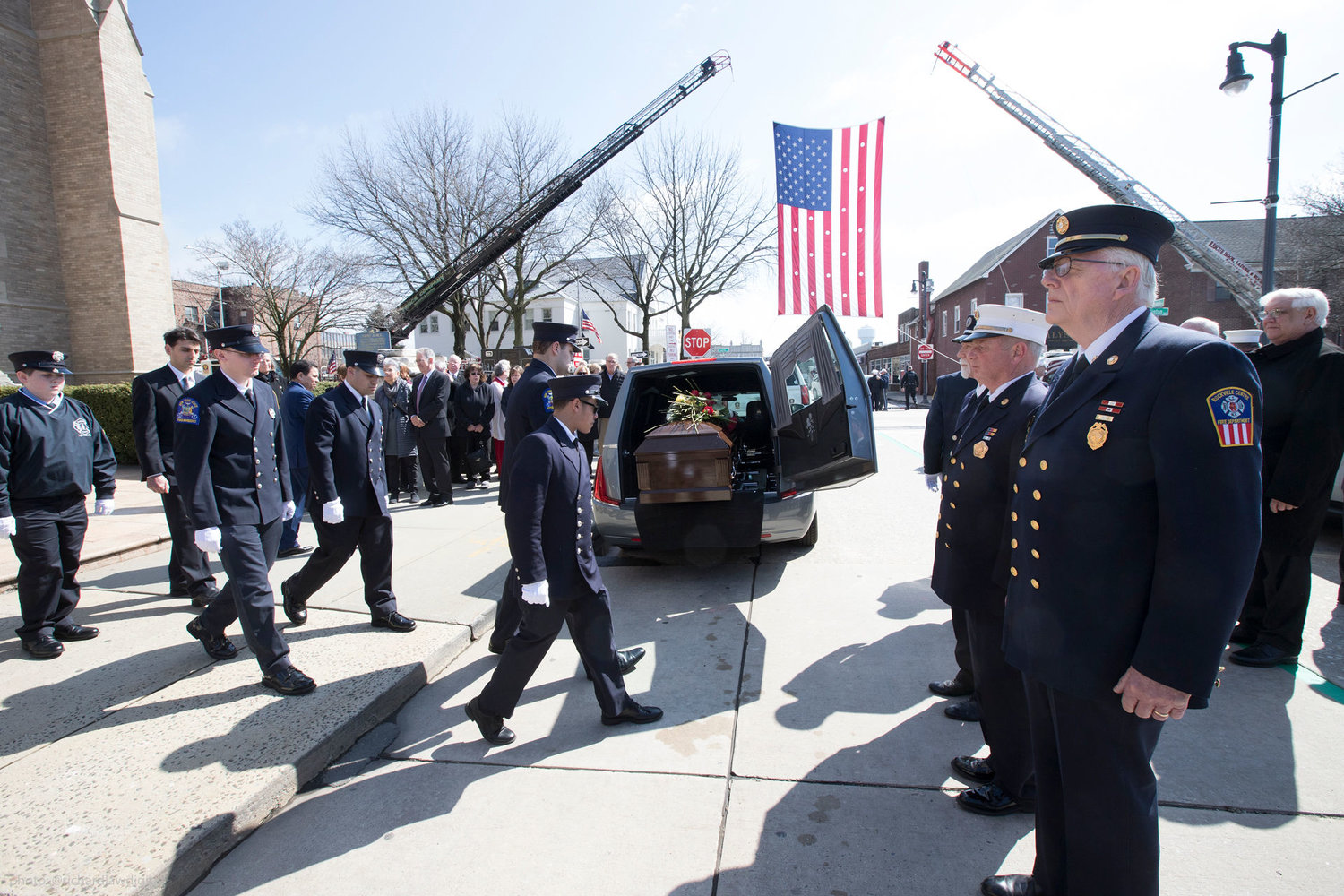 Firefighters, left, paid their respects.