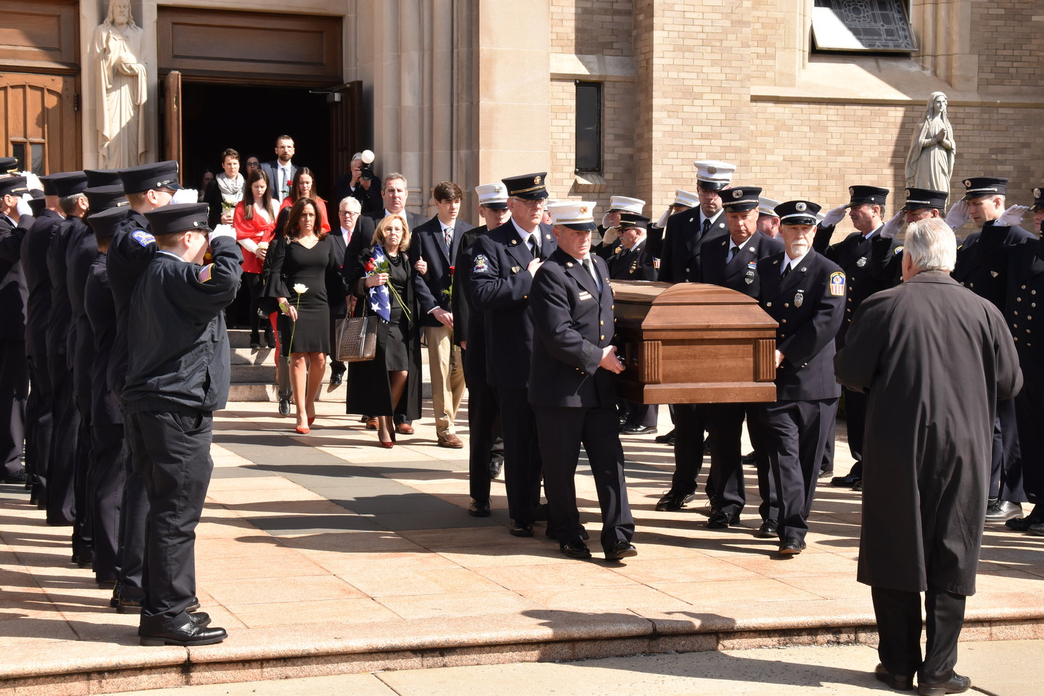 Firefighters carried the body of Eugene J. Murray out of St. Agnes Cathedral after a funeral Mass last Saturday. The former mayor and fire chief died on April 2, at 93.