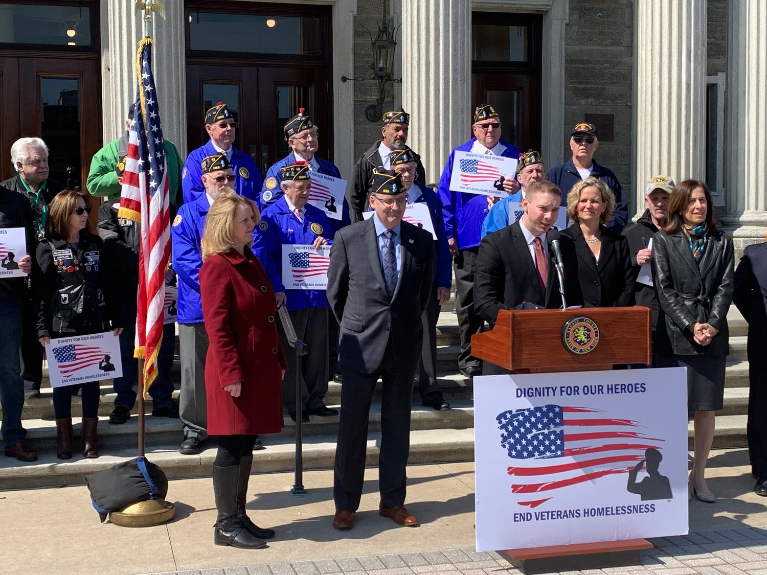 Legislator Josh Lafazan introduced two bills to end veteran homelessness in Nassau County in Mineola on April 3. To his left was County Executive Laura Curran.
