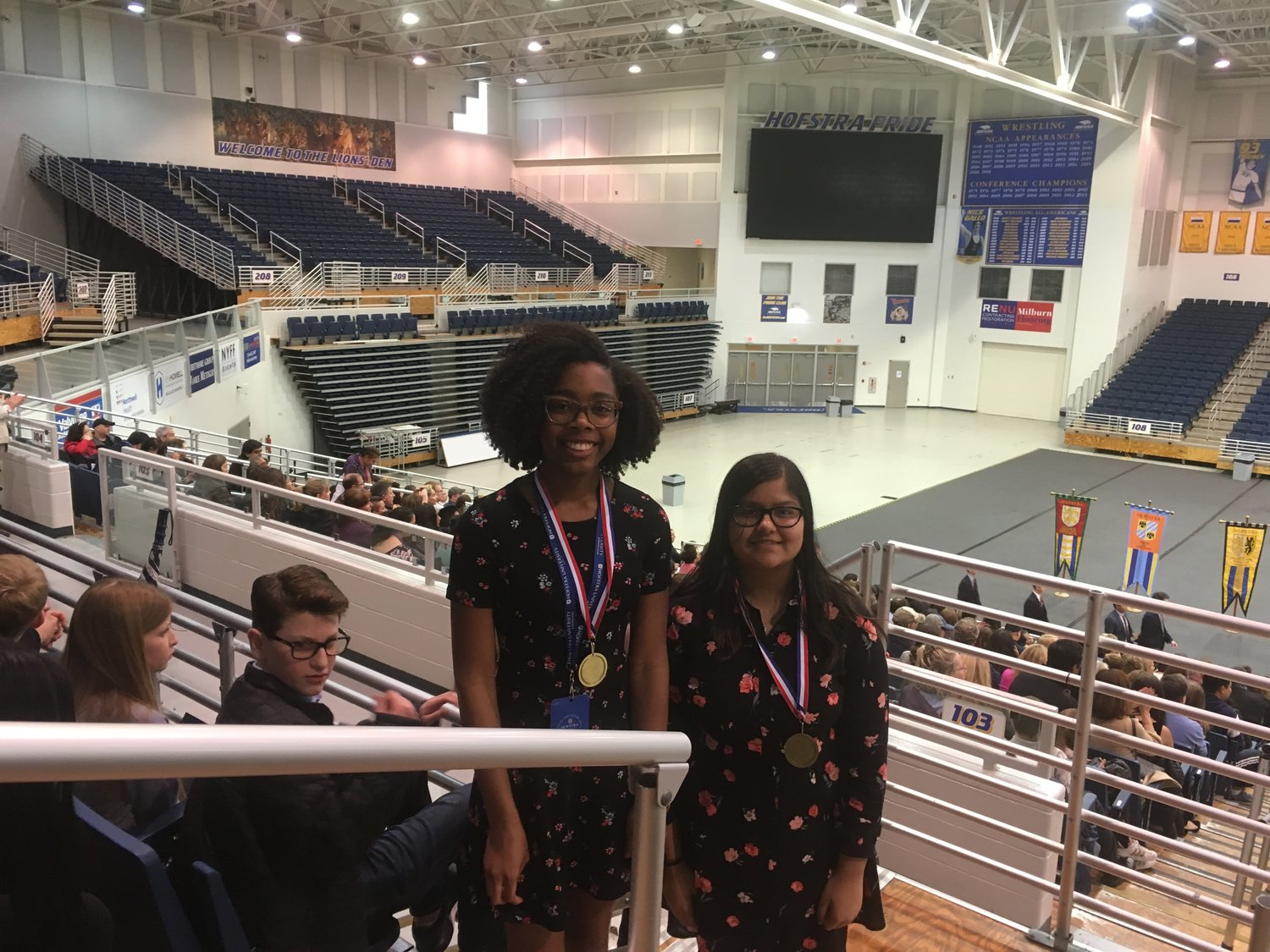 Faith Fuller, left, and Shreejita Satpathy, right, of W.T. Clarke Middle School garnered fourth place in the Junior Group Documentary category at the Long Island History Day regional competition on March 31 at Hofstra University.