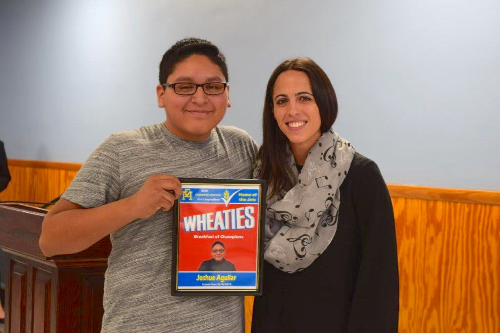 Joshue Aguilar earned honors from East Meadow High School teacher Brittany Dagro, left.