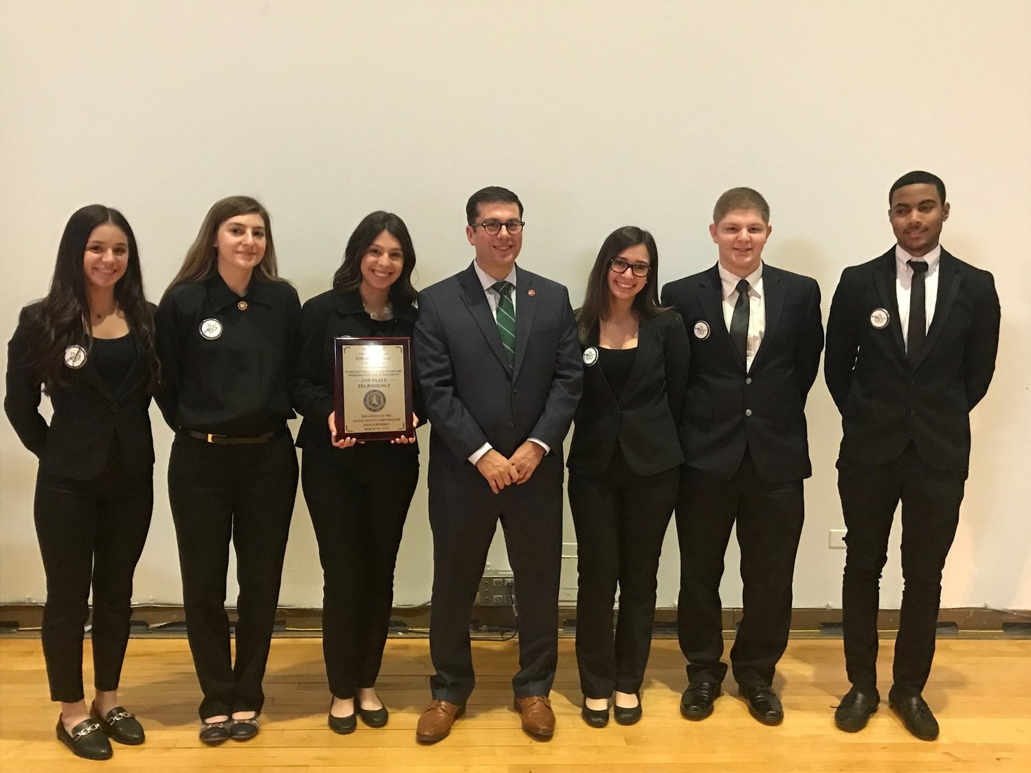 "East Meadow High School students earned second place in the category of technology for their machine ""Drop Cycle"" at the Comptroller's Entrepreneurial Challenge on March 29 at SUNY Old Westbury."