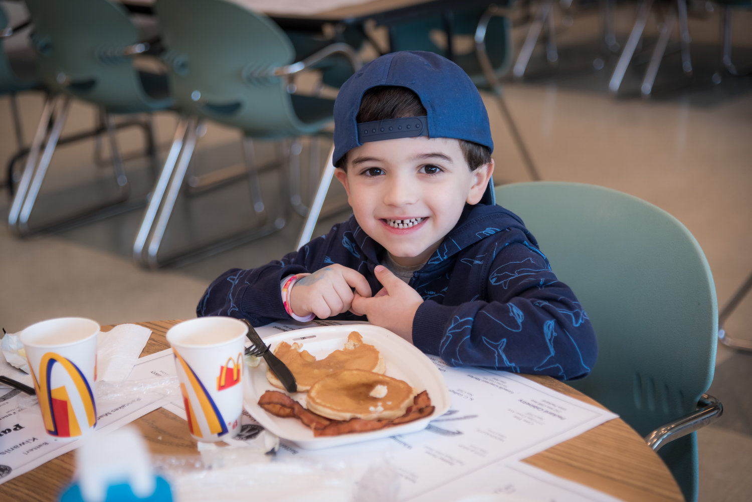 JR Russo, 4, was delighted to spend his Sunday morning eating piping-hot pancakes.