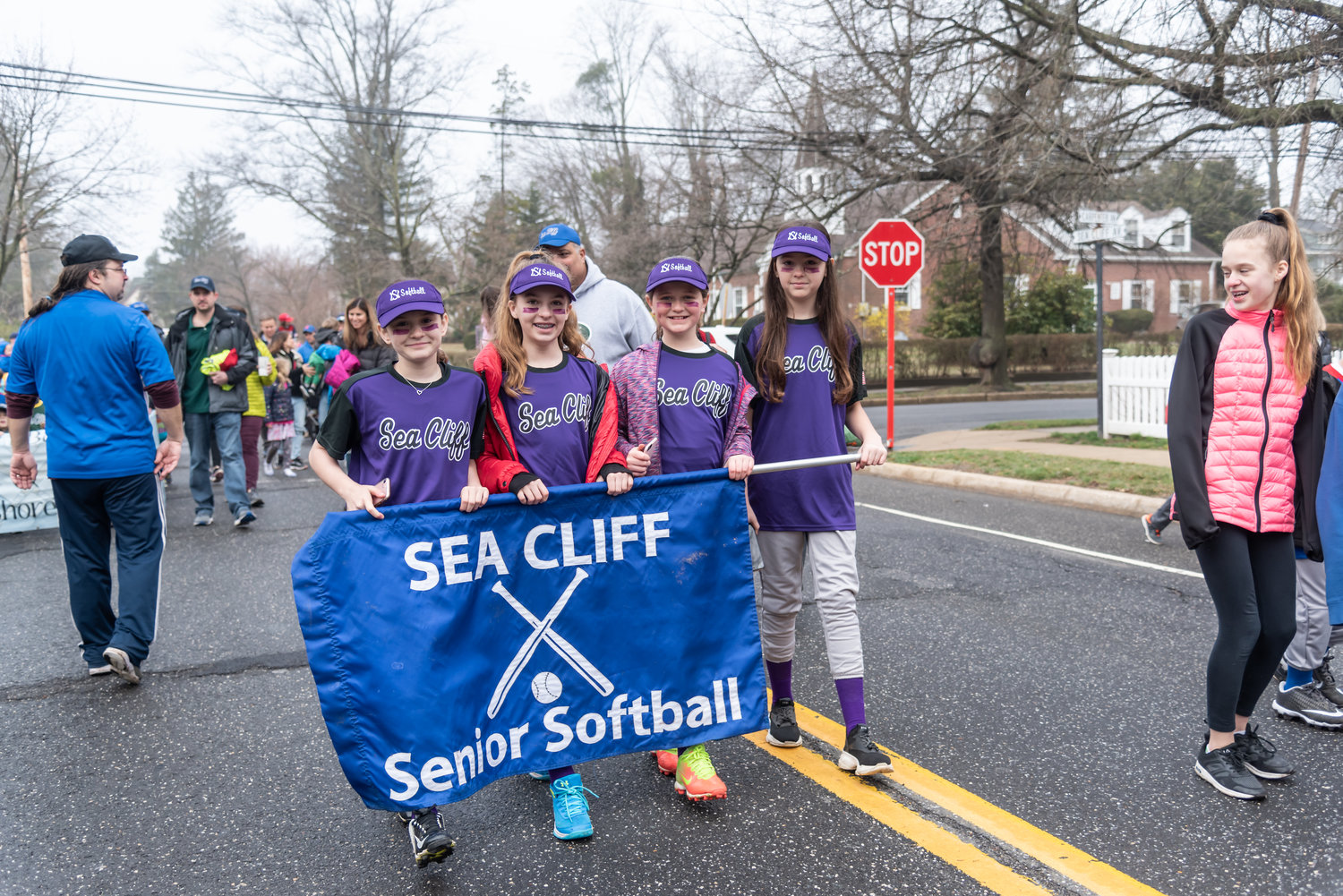 Louisa Ludmar, left, Aquinnah McDermott, Kasey Hart and Malia Gasparri showed their spirit, sporting purple-colored eye black to match their uniforms.