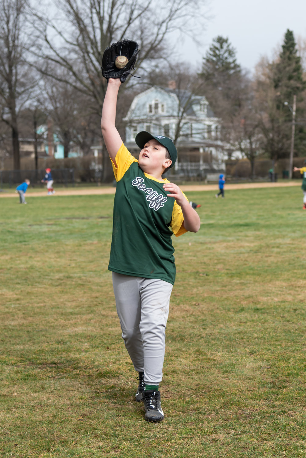 Jack Martin, 10, was skillful in catching a fly ball while practicing before the first game of the season.