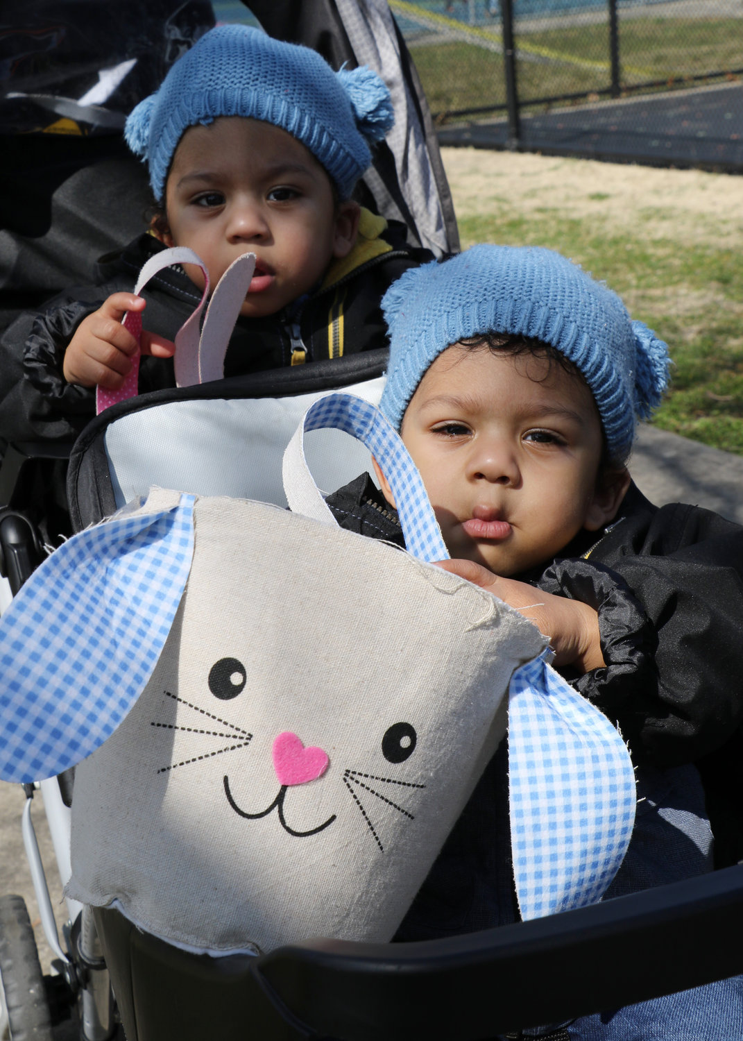 Two-year-old twins Oaura and Winter Santos had their bunny baskets ready to some sweets
