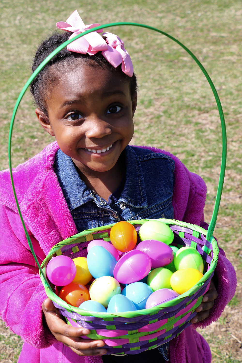 Brielle Volcy, 4, was more than happy with the colorful loot she gathered at Freeport's annual egg hunt last Saturday.