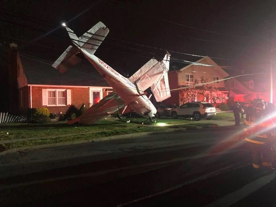 The plane became caught up in the wires in front of the home.