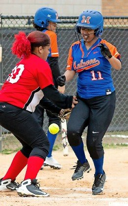 Malverne's Subhadra Debnath, right, reached home plate last Friday and the Lady Mules were tied with Freeport before a big inning led to an 18-7 loss.