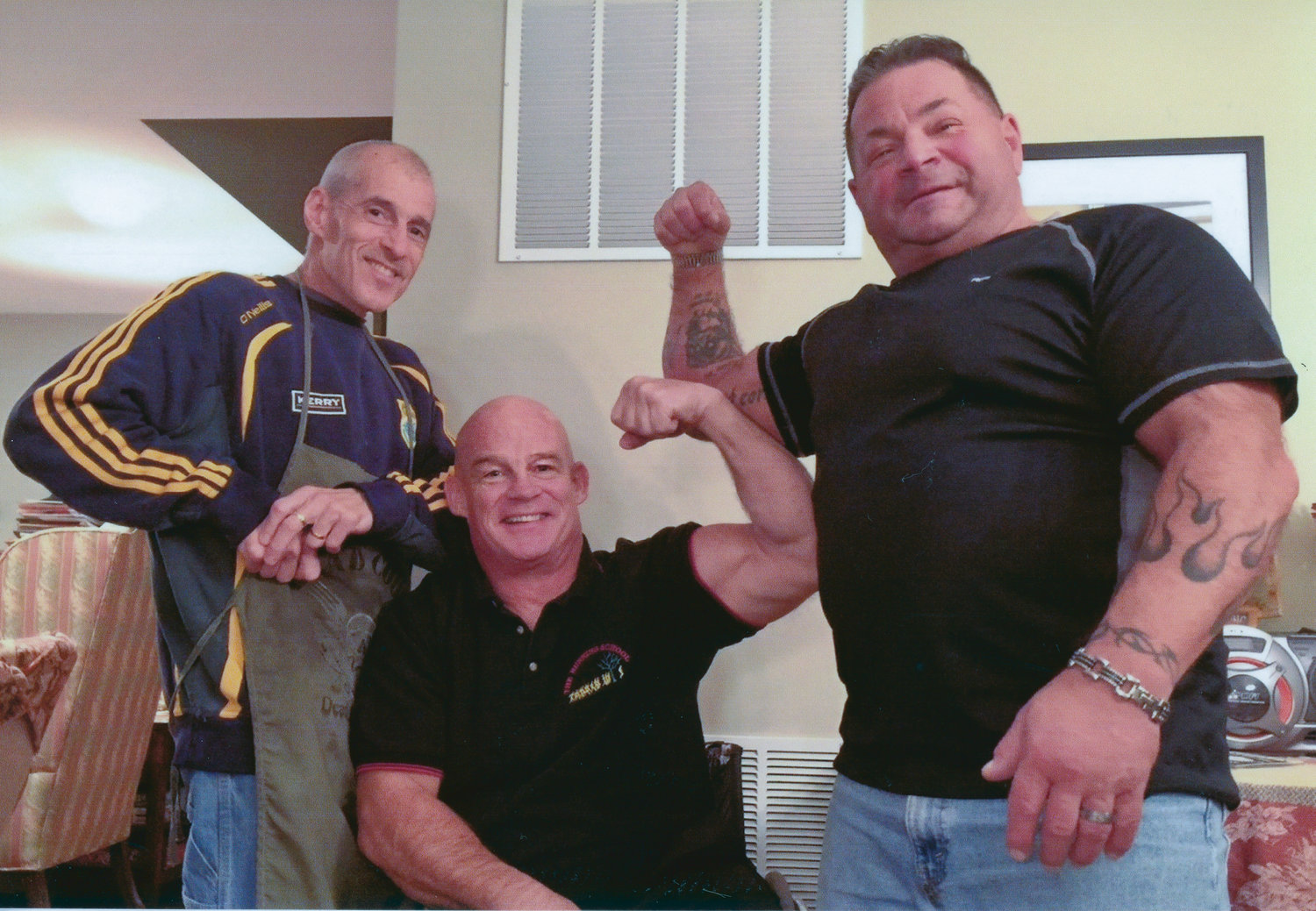 Leistner, left, with wheelchair racer Peter Hawkins, center, and professional weightlifter Pat Susco.