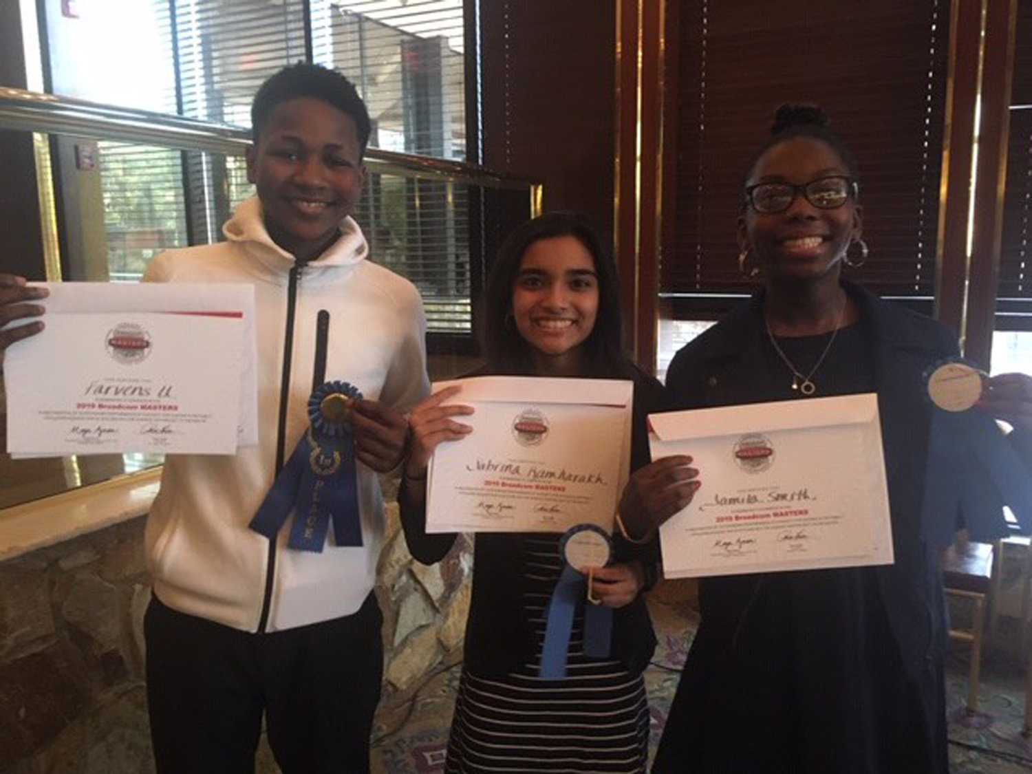 Farvens Ulysse, left, Sabrina Ramharakh and Jamila Smith won first place for their investigation into the relative absorbency of different paper towels.