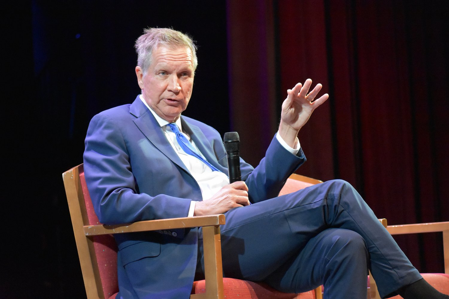 Former Ohio Gov. John Kasich visited the Madison Theatre at Molloy College on April 10 to speak about making a difference in one's community and the world. Above, he first spoke with students.