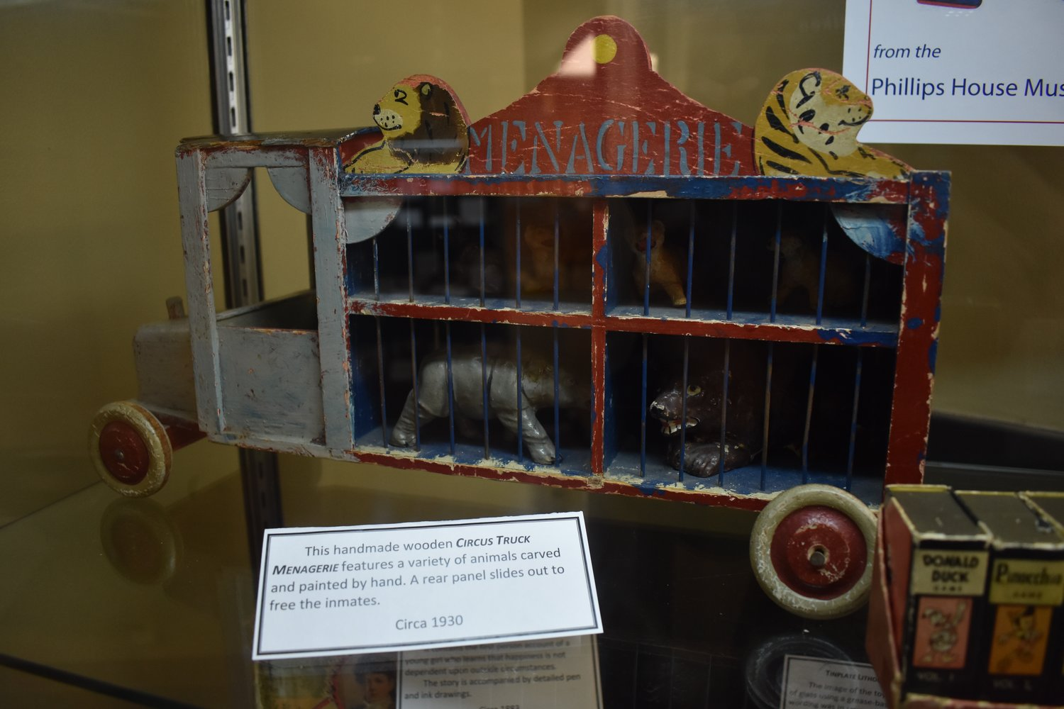 Among the vintage toys are a wooden circus truck holds animals carved and painted by hand.
