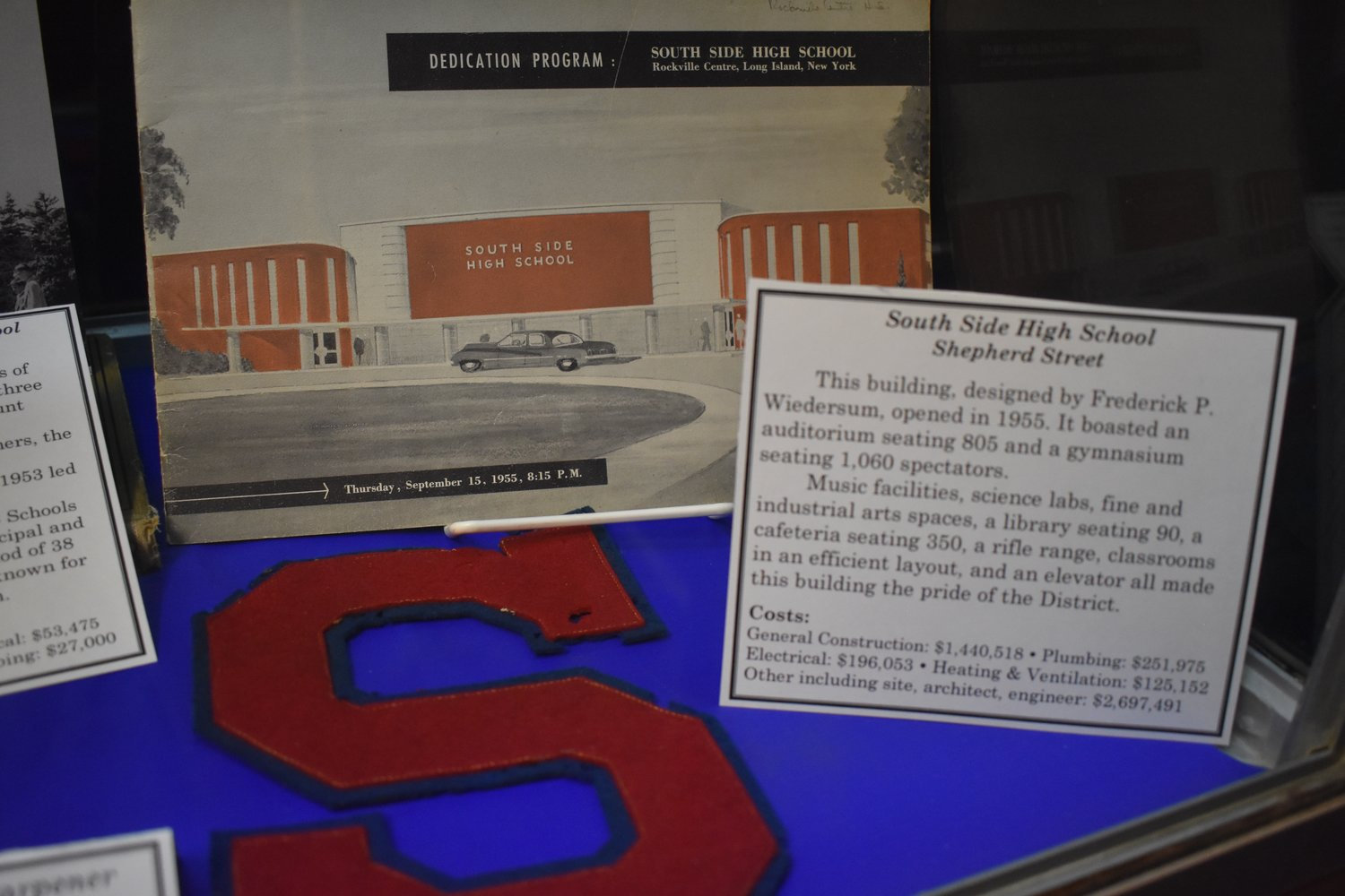 A South Side High School patch and a dedication program from 1955, when the school opened its doors at its current Shepherd Street locations are among the artifacts on display.