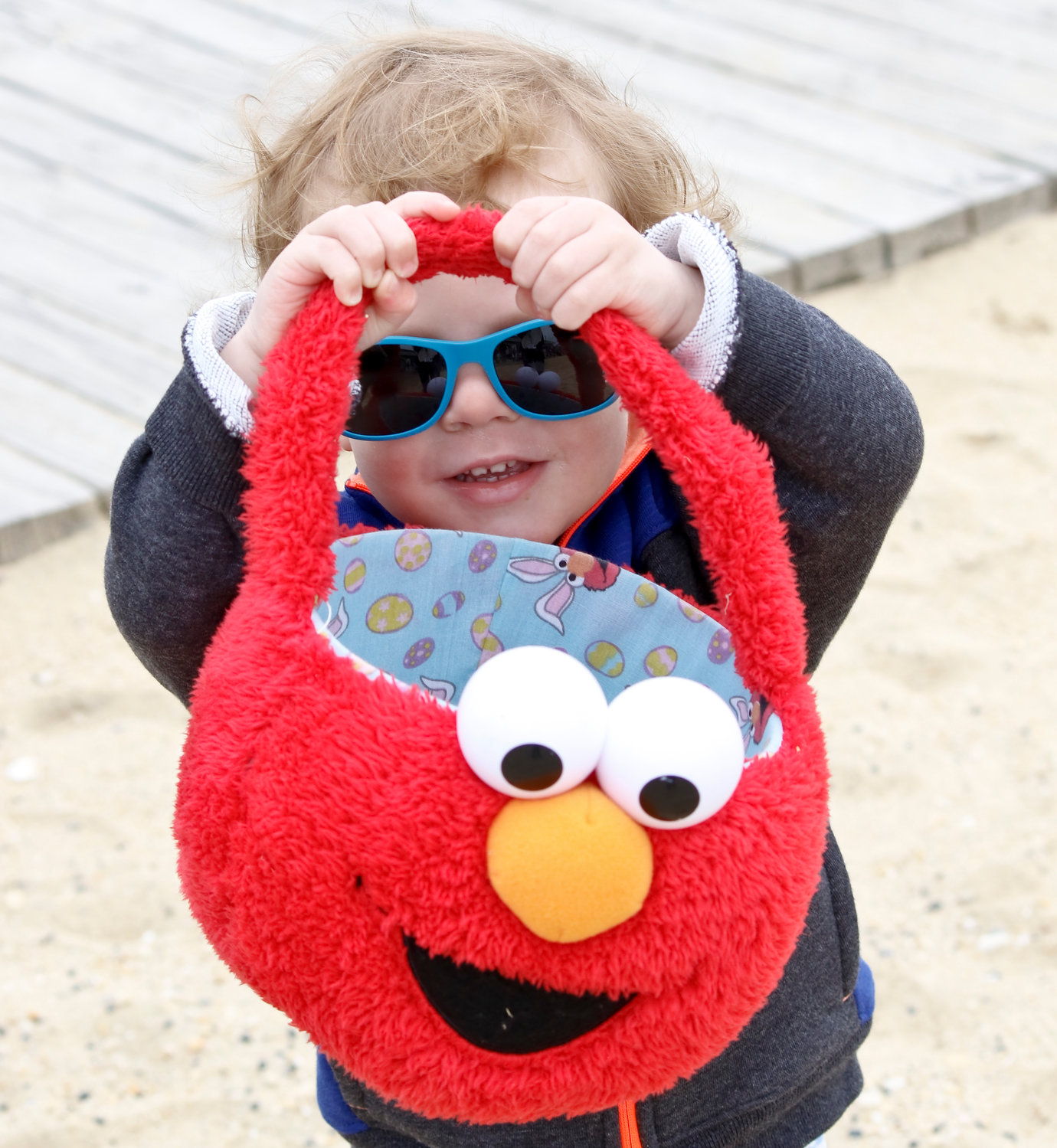 Oliver Roth, 2, collected eggs in an Elmo basket at his first egg hunt.