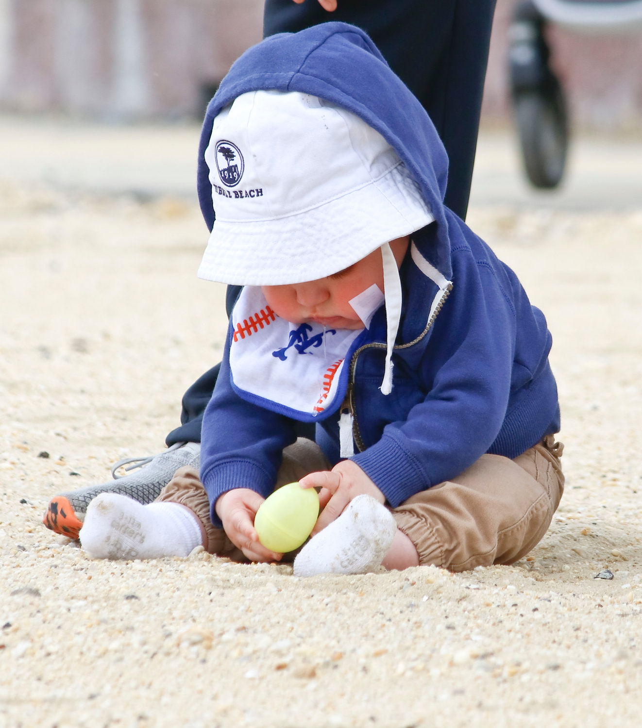 Seven-month-old Ryan O'Shea wasn't quite sure what to do with the plastic egg he found.