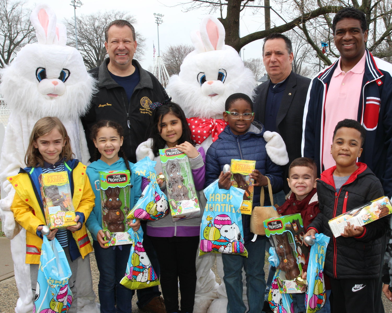 Mayor Ed Fare, Trustee John Tufarelli and Deputy Mayor Sean Wright, along with Mr. and Mrs. Rabbit, presented chocolate bunnies to Leyla Ozelge, Mary Ann Khan, Emmauel Velasquez, Nicholas Kaminsky, Logan Dickens and Jermiah Belizaire for finding gold and silver eggs.