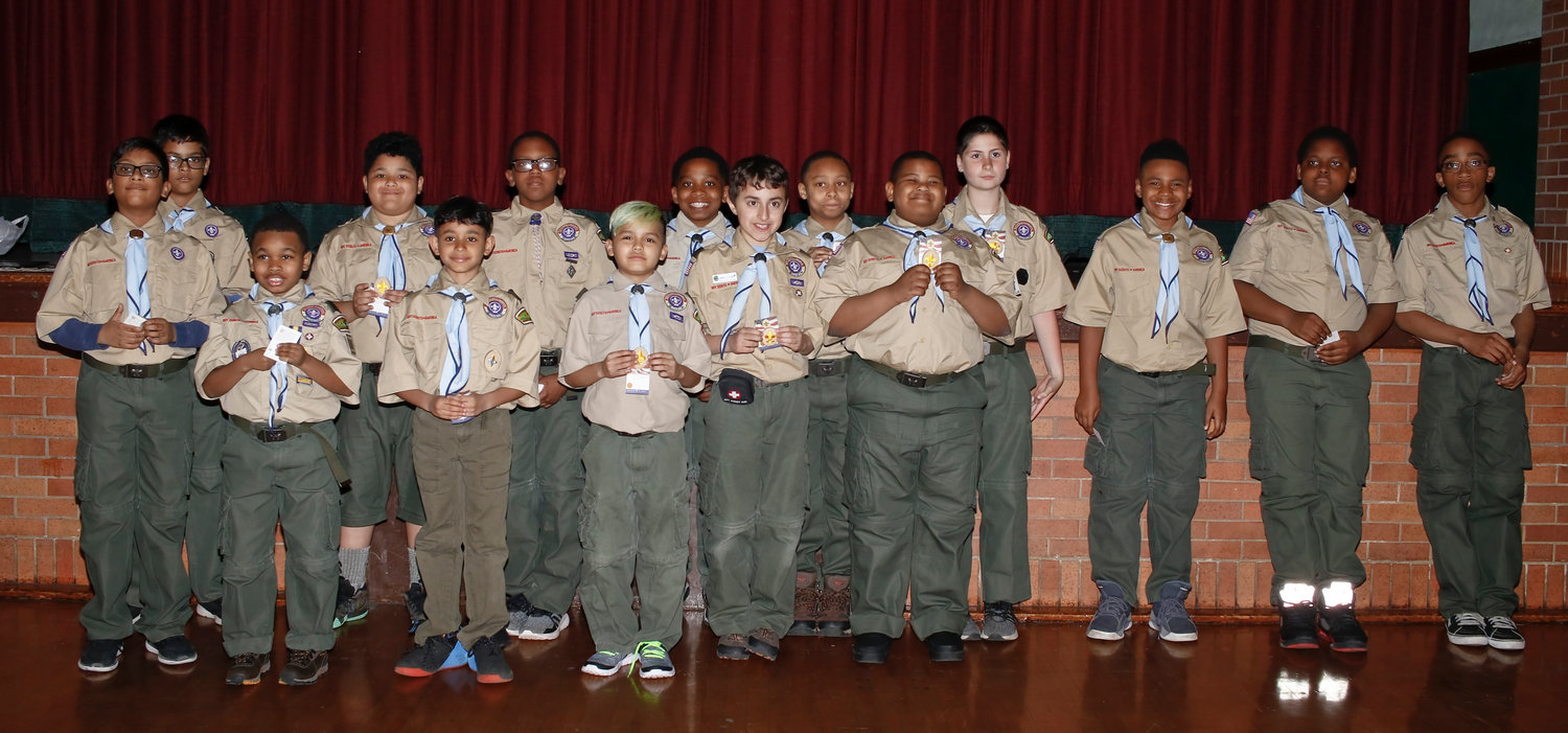 Fifteen scouts from Troop 116 received their Scout Rank advancement badge at the troop's Court of Honor ceremony on April 15.
