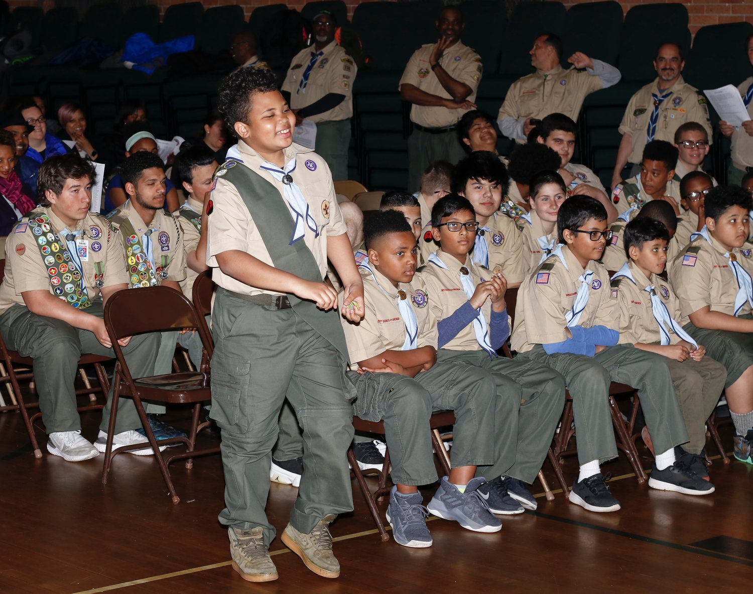 Second Class Rank Scout Michael Gay walked up to the podium to accept his Public Health Merit Badge. He also received badges for Citizenship in the Nation, Landscape Architecture, Moviemaking, Music and Personal Management.