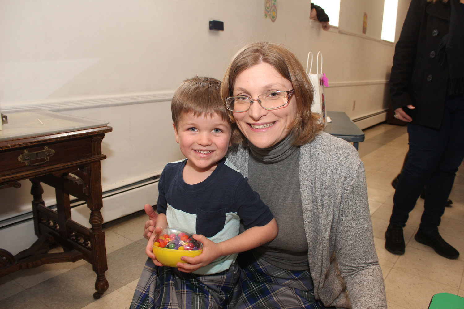 Trevor Roth, 4, with his mother, Marjory, tried to guess the right amount of jellybeans there were inside of an egg.