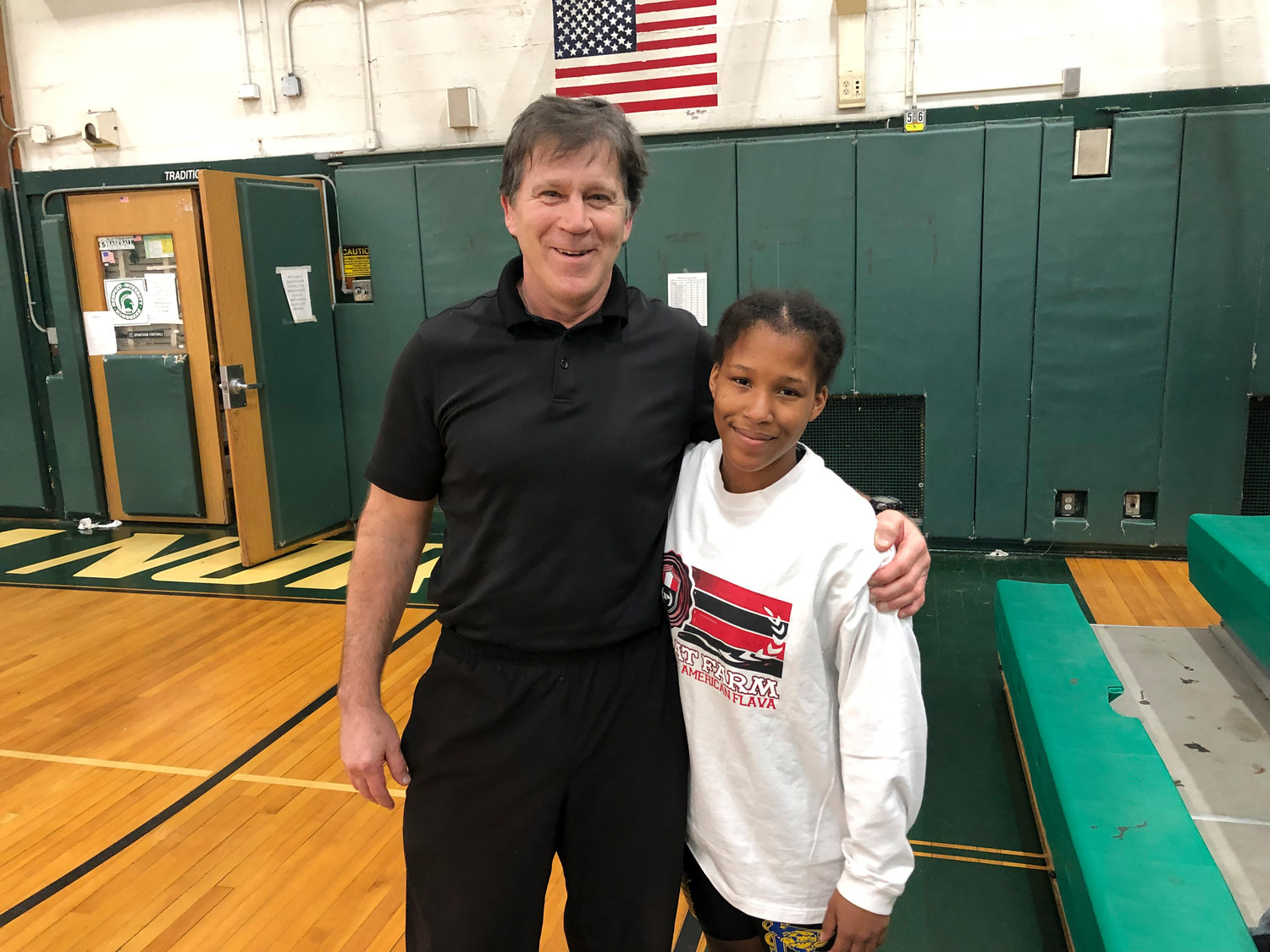 Lawrence Middle School wrestling head coach John Sauerland, left, was blown away by the efforts of eighth-grade wrestler Equality Gater.