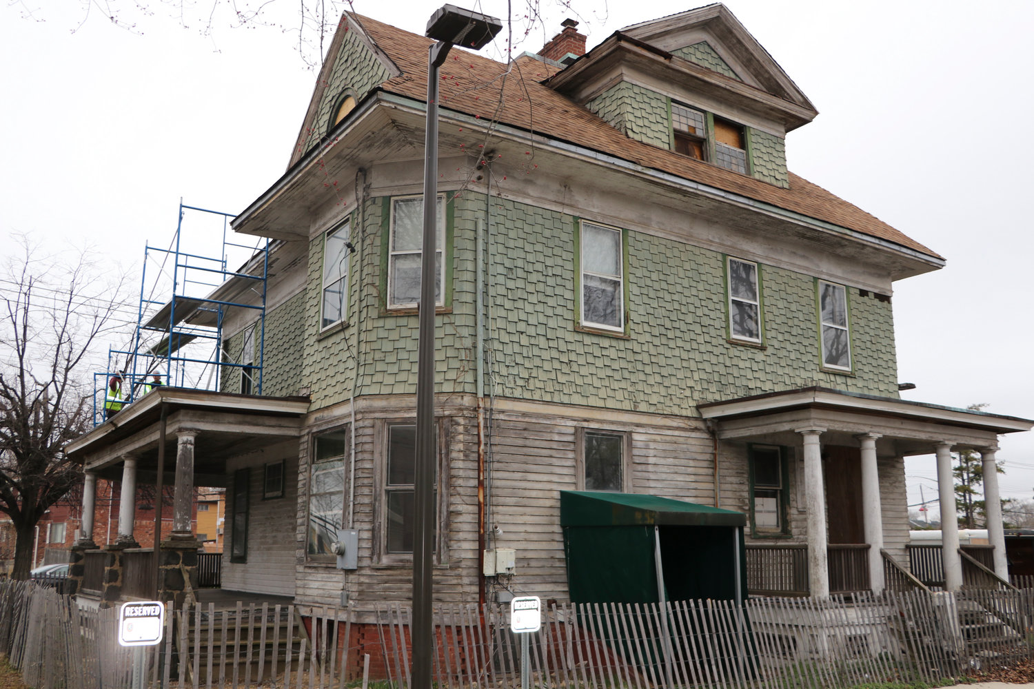County workers began removing the roof of Baldwin's historic Kellogg House to replace it with a new, historically accurate one. The work marks the start of the house's long-awaited restoration.