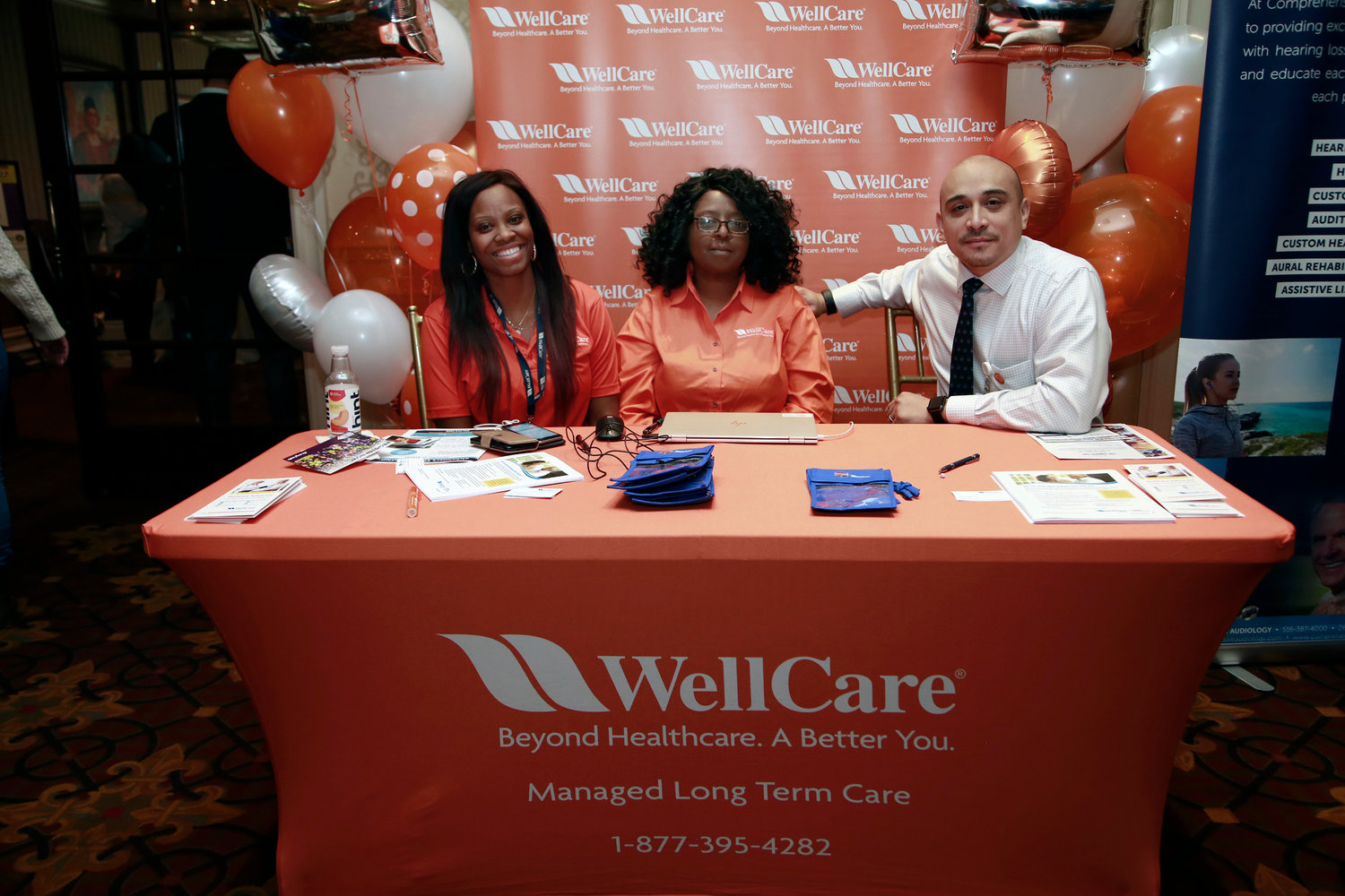 Sasha Scott, left, Eunice Rivers and Walter Aguilar educated seniors about WellCare, an insurance program that focuses on long-term care.